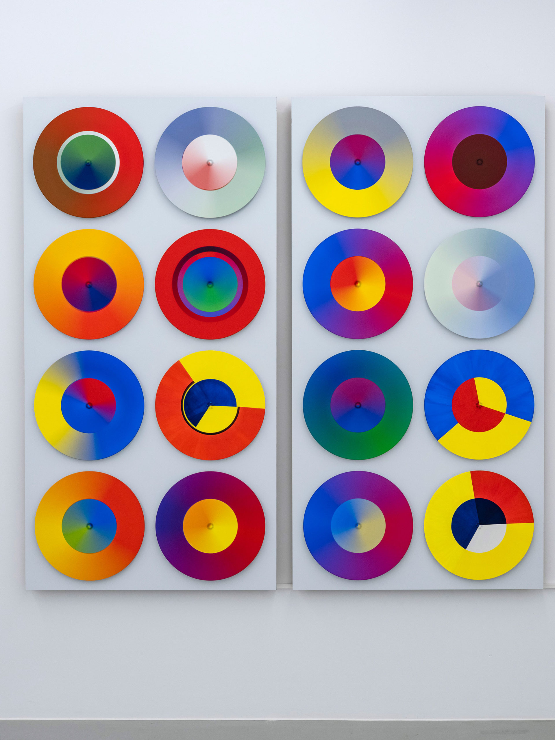 Mama Ocllo is a large kinetic painting of 16 spinning disks made by Madeleine Kelly and shown at Milani Gallery, printed in artist profile magazine
