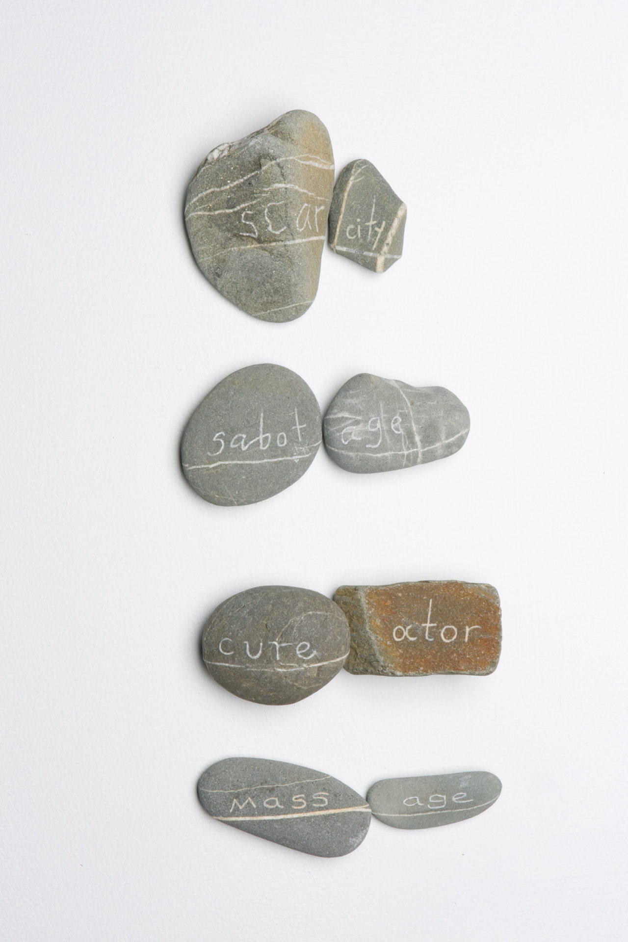 Rock Poem - Scarcity 2013 engraved beach stone with cross contour of quartz